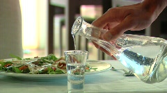 Vodka and Food in bar - stock footage