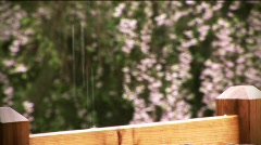Rain on Porch rail Stock Footage
