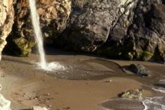 Waterfall on pristine beach zoom V2 - NTSC Stock Footage