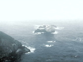 Mist over rugged seascape V2 - NTSC Stock Footage