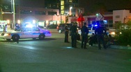 Crime and justice, police and suspects, wide shot Stock Footage
