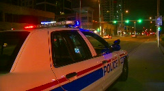 Crime and justice, police car, late night, lights flashing with traffic in bg Stock Footage