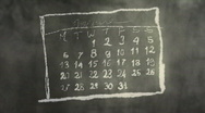 Calendar Month Page Scribbling on a Chalkboard HD Stock Footage