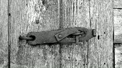 Rusty metal heck on the old wooden door - stock footage