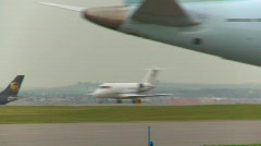 Stock Video Footage of aircraft,  Canadair CL-600-2B16 Challenger 604 takeoff, follow tight frame