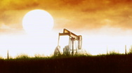 Stock Video Footage of t203 oil pumper oil company drill drilling sunset pollution