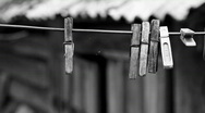 Stock Video Footage of old wooden clothes pegs hanging on the wire