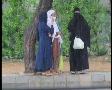 Women In Burqahs Standing in Rain Footage