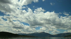 Clouds over Lake and Mountains Timelapse Stock Footage