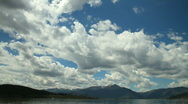 Stock Video Footage of Clouds over Lake and Mountains Timelapse