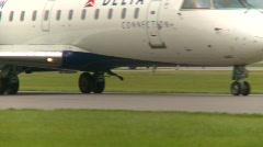 Stock Video Footage of aircraft, Canadair CL-600-2B19 Regional Jet CRJ-200LR taxi Zoom