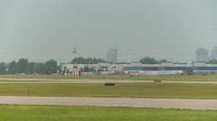 Aircraft, Piaggio P-180 Avanti, #3 taxi with city skyline in BG Stock Footage