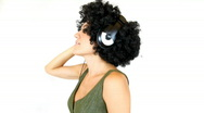 Stock Video Footage of Woman with afro listening to music, isolated on white