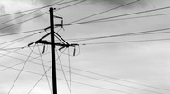 Stock Video Footage of Power lines on the background of the cloudy sky