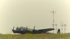 aircraft,  WWII Lancaster bomber, #16 idle with antennae in BG - stock footage