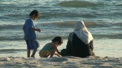 Malasian family on the beach Stock Footage