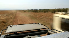 Trucks Pass on African Dirt Road (HD) co Stock Footage