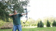 Archer shoots with Bow and Arrow Stock Footage