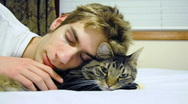 Stock Video Footage of Sleeping with a Pet Cat