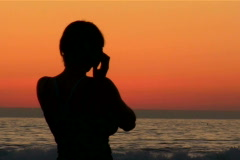 Woman on cell phone silhouette - NTSC Stock Footage