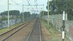 Train moves slowly on railway track Stock Footage