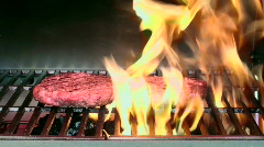 Flaming Hamburgers Cooks On Grill Stock Footage