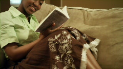 Around The House: Reading A Book 02 (720p / 23.98) Stock Footage