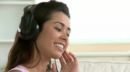 Stock Video Footage of Cheerful asian woman listen to music