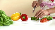 Stock Video Footage of Close-up of an asian woman cutting vegetables