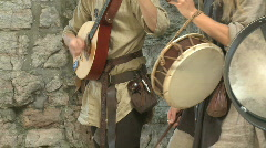 Musician playing on old instruments during medieval week in visby sweden - stock footage