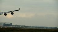 Stock Video Footage of Plane landing at International Airport