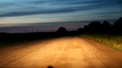 night dirt road from a moving car - stock footage