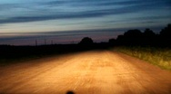 Night dirt road from a moving car Stock Footage