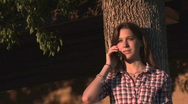 Stock Video Footage of Young Woman Chats on Cell Phone