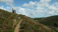 Time lapse path to Tywarnhayle tin mine engine house. Stock Footage