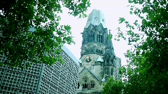 Berlin - Kaiser Wilhelm Memorial Church with Weaving Trees Stock Footage