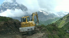 Construction vehicle in front of eiger Stock Footage