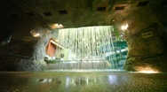 Stone cave with a waterfall in waterpark Stock Footage