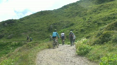 Mountain bikers and hikers Stock Footage