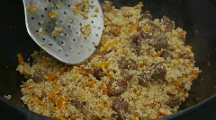 HD1080p Plov being prepared in a kazan in Central Asia Stock Footage