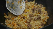 Stock Video Footage of HD1080p Plov being prepared in a kazan in Central Asia
