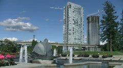 Vancouver (Surrey) Urban Park with Sky Train Transit System Stock Footage