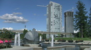 Stock Video Footage of Vancouver (Surrey) Urban Park with Sky Train Transit System