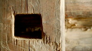 Stock Video Footage of old log wall - expressive texture and hole