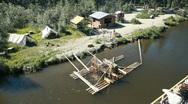 Alaska Fishing village from river boat P HD 7844 Stock Footage
