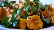 Stock Video Footage of Chanterelle Turning Dish with Herbs - Variant 1