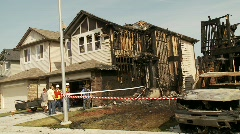 Post fire scene multihome, pan Stock Footage