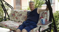 Stock Video Footage of Old retired man on porch swing