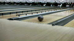 Throwing Bowling ball down lane Stock Footage