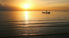 Fishing boat in the sea in sunset time - stock footage